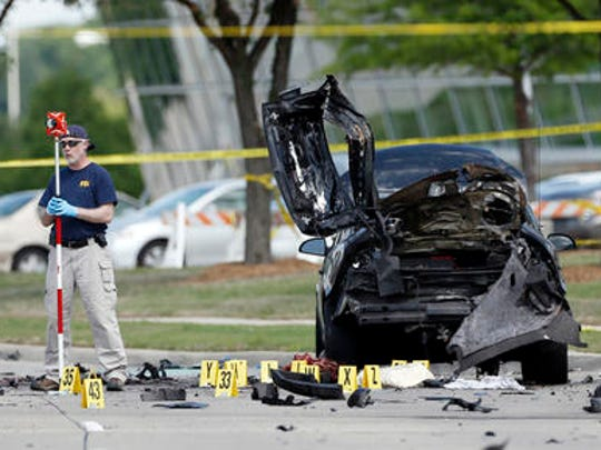 FILE - In this May 4, 2015 file photo, FBI crime scene investigators document evidence outside the Curtis Culwell Center in Garland, Texas. Sentencing is set Wednesday, Feb. 8, 2017, for American-born Muslim convert Abdul Malik Abdul Kareem, who was convicted of helping to plot a 2015 attack on a Prophet Muhammad cartoon contest in Texas.