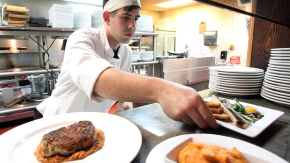 Gregory Doucet preps dishes at Jolie's Louisiana Bistro in Lafayette.