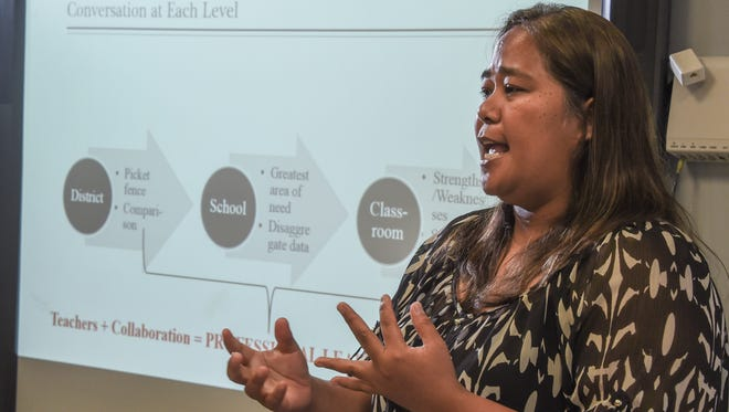 Division of Curriculum and Instruction School Program Consultant Carla Aguon explains how the teamwork of various stakeholders, from education administration level to the teacher and parent level, can effect a student's ability to learn, during a press conference at the Guam Department of Education headquarters in Tiyan on Monday, Sept. 26.