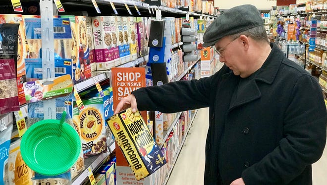 Self-proclaimed Frosted Flakes fanatic Robert Laplander explores the expansive cereal selection at Pick 'n Save on Greenfield Ave. in Brookfield.