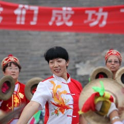 People in  Zhangjiakou in northern China's Hebei province celebrate on July 31, 2015, after the city and Beijing were named co-hosts of the 2022 Winter Olympic Games.