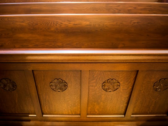 Dogwood flowers were carved into the pews inside the