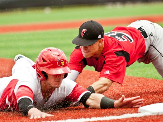 In the bottom of the third, Louisville Cardinals' Zach Lucas singles and teammate Sutton Whiting advances to second, but when Whiting tries for 3rd, he's caught by Cincinatti Bearcats' 3rd baseman Ryan Quinn for the final out of the inning. 17 May 2014