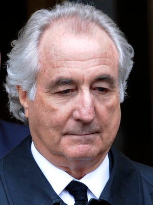 March 2009 file photo, shows Bernard Madoff leaving a Manhattan federal court hearing in New York  City.
