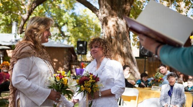 Tanya Struble looks at Therese Councilor during their wedding Oct. 19. The couple, who have been together for 23 years, were officially married over the summer.