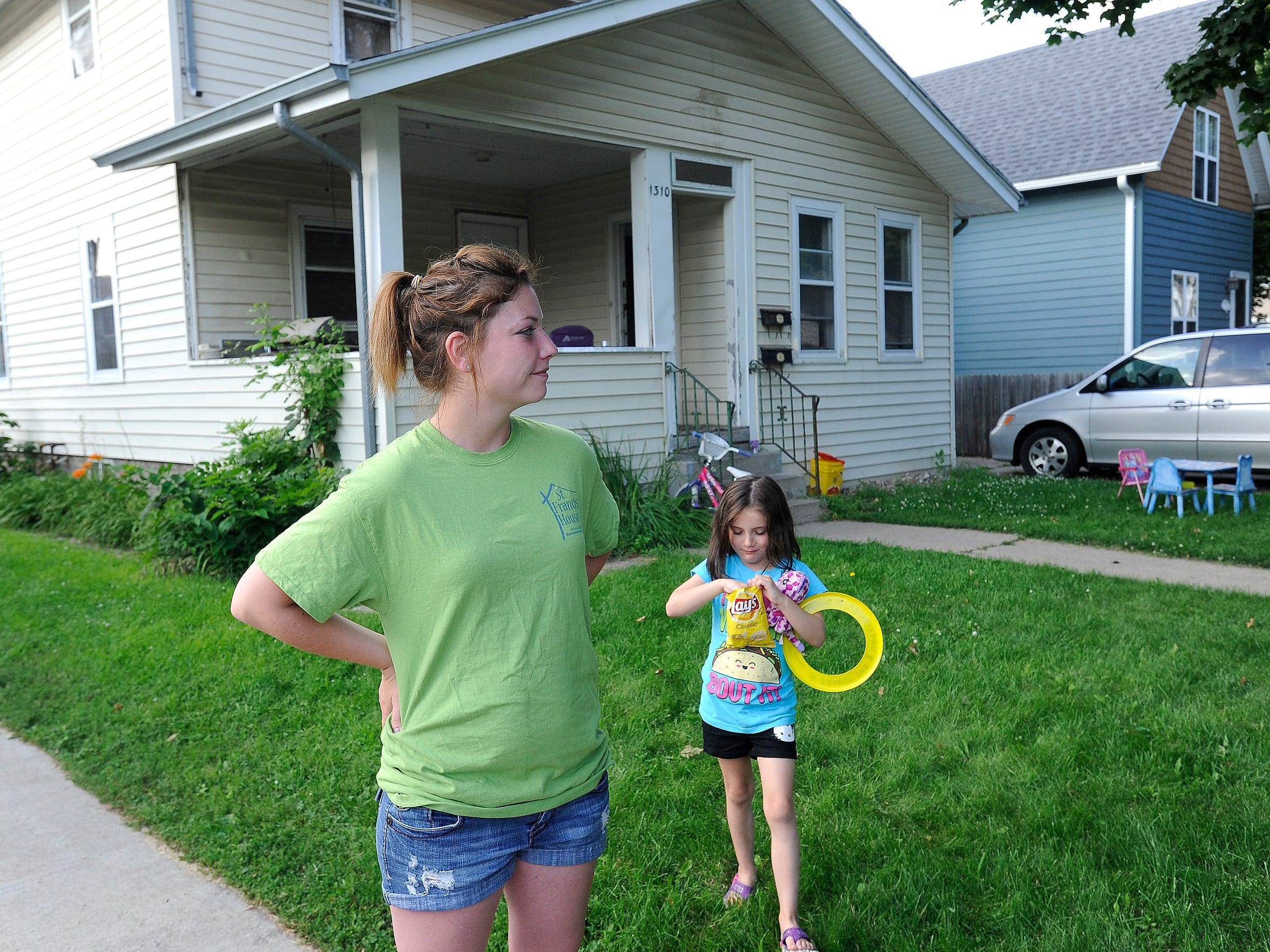Allisha Hanson and her daughter Presley, 6, talk about living in the Whittier neighborhood in Sioux Falls, S.D., Thursday, July 9, 2015. Allisha works on the St. Francis House but they will be moving out of the Whittier neighborhood.