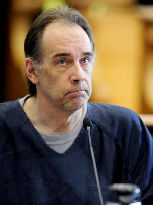 Former police officer Steven Zelich sits in court in the first day of his trial Monday in Kenosha, Wis. Zelich pleaded guilty in the death of 19-year-old Jenny Gamez, of Cottage Grove, Oregon, whose body was found in a suitcase along a Wisconsin highway in August 2012. He will be sentenced in March, and could spend as many as 55 years in prison.