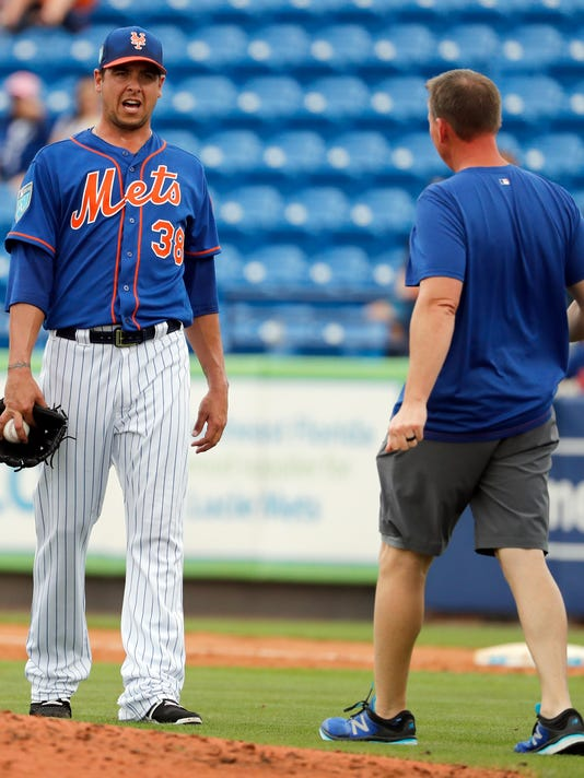 New York Mets pitcher Anthony Swarzak (38) talks to a trainer before leaving an exhibition spring training baseball game against the Houston Astros during the third inning Tuesday, Feb. 27, 2018, in Port St. Lucie, Fla. (AP Photo/Jeff Roberson)