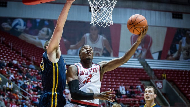 Ball State's Bo Calhoun shoots past Toledo's defense during their game at Worthen Arena Wednesday, Jan. 6, 2016.