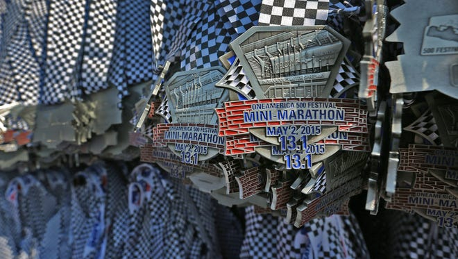 OneAmerica 500 Festival Mini-Marathon medals await being handed out to finishers, Saturday, May 2, 2015.