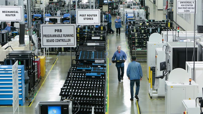 Magna International workers assemble and test various camera systems made for automobiles at Magna Electronics in Holly on Friday October 28, 2016.