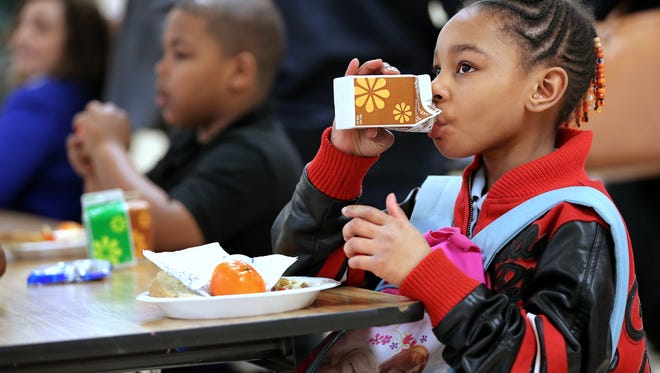 Bre'Shae Frazier of Indianapolis enjoys a free meal after the celebration ceremony and ribbon cutting that unveiled the newly renovated and expanded kitchen at the Boys & Girls Club on East 30th Street in Indianapolis on Thursday, March 19, 2015. The renovations allowed the four freestanding clubs to double the size of their kitchens and cafeterias in order to increase hot dinner service from 50,000 to 70,000 kids per year.