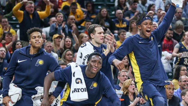 Players on the Indiana Pacers bench react during second half action between the Indiana Pacers and Brooklyn Nets in the home opener at Banker's Life Fieldhouse, Indianapolis, Wednesday, Oct. 18, 2017. The Pacers won, 140-131.