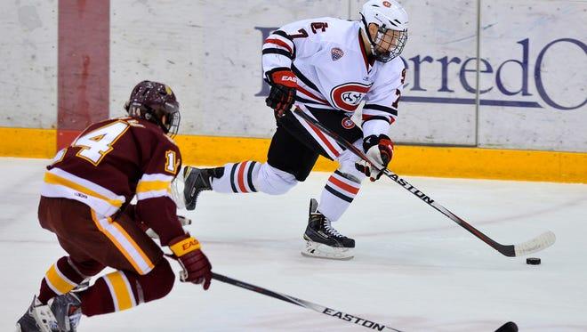 St. Cloud State's Niklas Nevaleinen (7) drives the puck up the ice ahead of Minnesota-Duluth's Alex Iafallo (14) in the first period Friday, Nov. 7 at Herb Brooks National Hockey Center.
