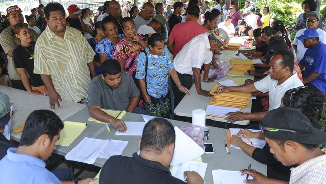 In this file photo from March, citizens from the island state of Chuuk, in the Federated States of Micronesia, line up to cast their votes for their island leaders during a Chuuk State General Election at the Mangilao Community Center.