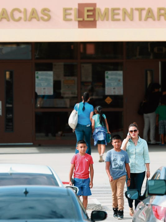 VICTOR CALZADA-EL PASO TIMES Frank Macias Elementary School was busy as parents of children made their way to the school Thursday to receive information about the exposure of students and staff to tuberculosis.
