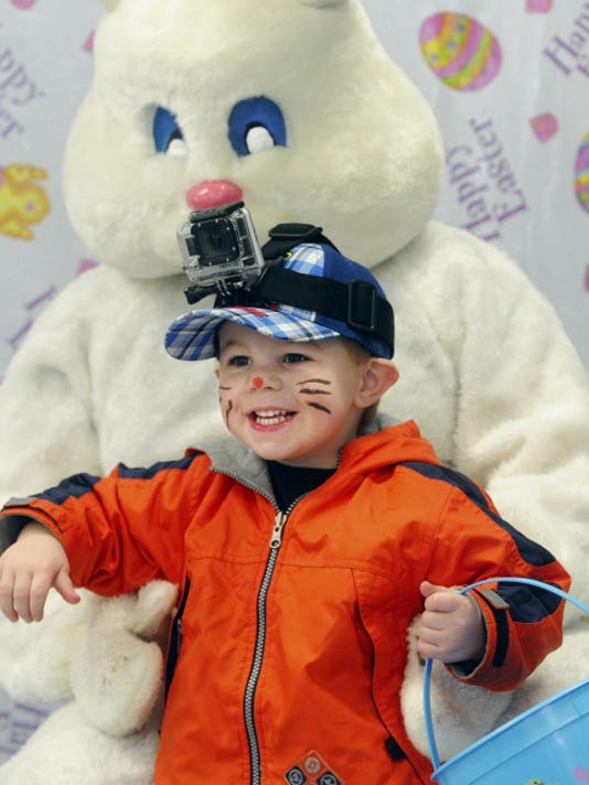 Weston Schrum, 2, of Dover, is all smiles as he poses with the Easter bunny. Schrum is wearing a Daily Record/Sunday News GoPro on his head to record his activities during the church's Easter egg hunt. To see the video, go to ydr.com.