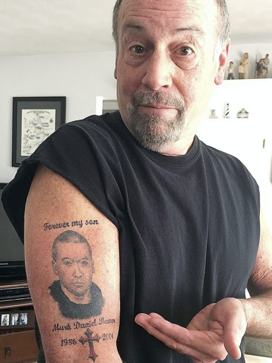Phil Bauer shows a tattoo of his son Mark, who died with prescription drugs in his system in 2004. Bauer tells his story in a video at yorkdispatch.com.