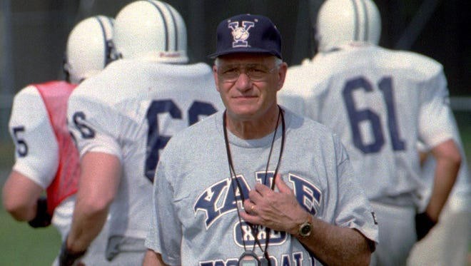 In this Aug. 27, 1996, file photo, Yale University head football coach Carmen Cozza walks across the practice field in West Haven, Conn. Cozza, who led Yale to a share of 10 Ivy League titles during 32 years as coach died Thursday, Jan. 4, 2018, the university said. He was 87.
