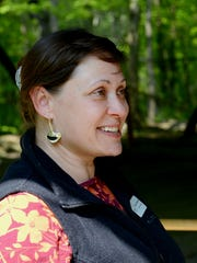 Archaeologist Stacy Tchorzynski talks about the history of the petroglyphs at  Sanilac Petroglyphs Historic State Park May 24, 2016 in Cass City.