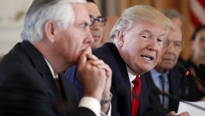 In this April 7, 2017, photo, President Donald Trump, joined by Secretary of State Rex Tillerson, left, speaks during a bilateral meeting with Chinese President Xi Jinping at Mar-a-Lago in Palm Beach, Fla. Lambasted for his low-key diplomacy, Tillerson is emerging from the shadows with his leading public role in shaping and explaining the Trump administration's missile strikes in Syria. He now takes on an even higher-profile mission, heading to Moscow this week under the twin clouds of Russia's alleged U.S. election meddling and its possible support for a Syrian chemical weapons attack. (AP Photo/AlexBrandon)
