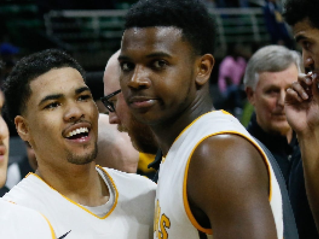 North Farmington's Amauri Hardy is all smiles after defeating Lansing Everett 60-48, during the MHSAA boys basketball Class A semifinals at the Breslin Center in East Lansing, Mich. on Friday, March 25, 2016.