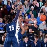 Photos: East Lansing vs Holt Boys Basketball