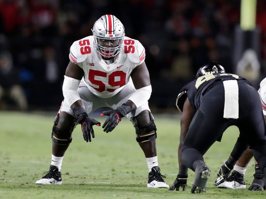Ohio State offensive lineman Isaiah Prince (59) plays against Purdue during the first half of an NCAA college football game in West Lafayette, Ind., Saturday, Oct. 20, 2018. (AP Photo/Michael Conroy)