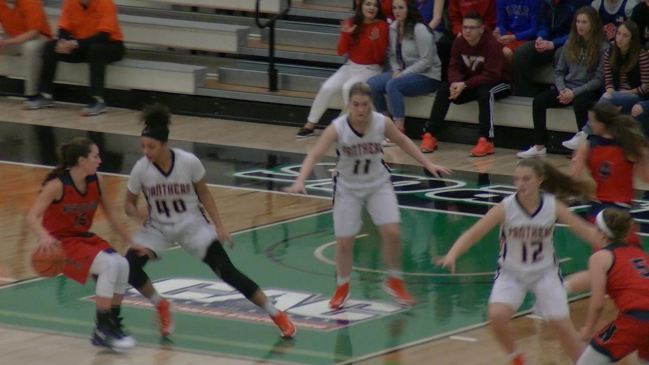 Central York's Emma Saxton leaps between New Oxford's