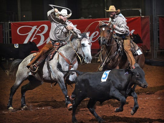 Cowboys from the RA Brown Ranch focus on the designated