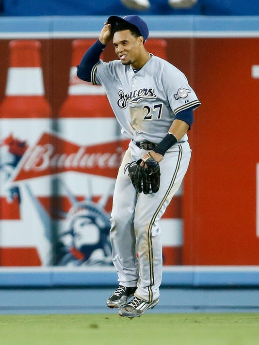 Milwaukee Brewers center fielder Carlos Gomez celebrates after a baseball game against the Los Angeles Dodgers, Saturday, July 11, 2015, in Los Angeles. Gomez had 5 RBIs and the Brewers won 7-1. (AP Photo/Danny Moloshok)