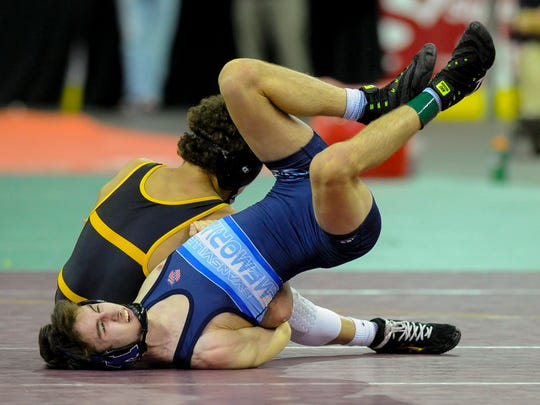 Memorial's Seth Horty, front, wrestles Avon's Asa Garcia during their 113-pound championship match during the Reitz wrestling semistate at the Ford Center, Saturday, Feb. 11, 2017. Horty finished second to claim the 113-pound semistate runner up title.