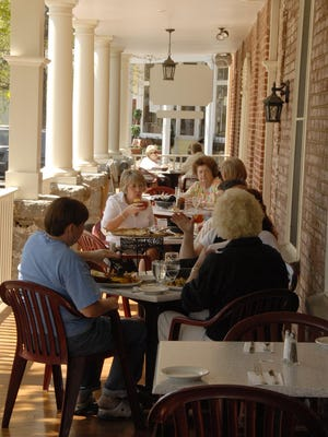 Diners enjoy the spring weather on the restaurant's front porch at the Publick House in Chester.