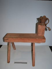A coffee grinder bench is among the artifacts made
