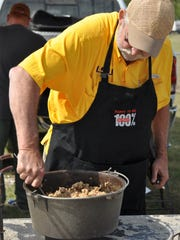 C.J. Paul stirs a pot of jambalaya on Saturday that