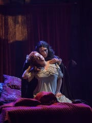 Giles Davies as Dracula and Miranda McGee as Lucy in