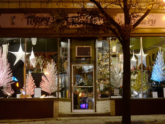 "File - Eight aluminum trees set up at The Flower Gallery for ""Evergleams on Eighth"" in 2015."