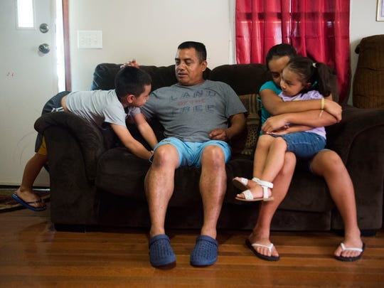 Alberto Librado, center, sits with his children from left, Abdiel, 5, Sheryln, 11, and Jeylani, 3, in their White Pine home July 3, 2018. Alberto was detained by ICE agents when they raided the Southeastern Provision plant outside Bean Station in April 2018.