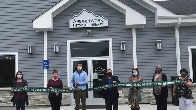 Cutting the ribbon for ApexNetwork Physical Therapy, in Lebanon, Maine is clinic owner, Danny Clark, along with employees and Greater Rochester Chamber of Commerce representatives.