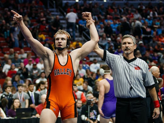 Joel Shapiro of Valley celebrates an 8-2 victory over Waukee's Brandon Tessau during their class 3A 182 pound championship match at Wells Fargo Arena on Saturday, Feb. 17, 2018, in Des Moines.
