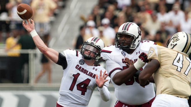 South Carolina quarterback Connor Shaw (14) delivers a pass during the Gamecocks' game vs. Central Florida at Bright House Networks Stadium in Orlando. Shaw left moments later with a right shoulder separation.