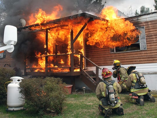 Volunteer firefighters from Brewster attack a trailer fire in a mobile home park on Danbury Road in Southeast on April 27, 2014. The Brewster Fire Department is giving tours and demonstrations at its firehouse on April 28 for RecruitNY.