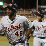 Detroit Tigers' outfielder Torii Hunter heads to the dugout after his solo home run off of Minnesota Twins relief pitcher Casey Fien, a former Tiger,  in the ninth inning Monday, Sept. 15, 2014, in Minneapolis. Miguel Cabrera, right, followed Hunter with a solo home run. The Tigers won, 8-6.