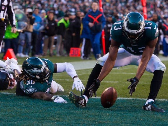Eagles' Nelson Agholor picks up a fumble by teammate