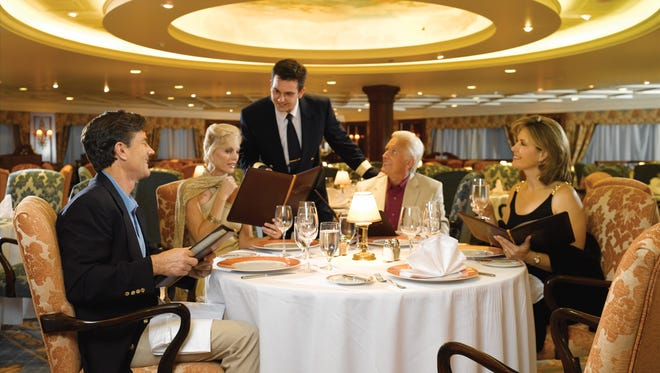 Oceania passengers in the Grand Dining Room of one its ships.