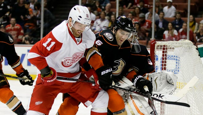 Daniel Cleary has spent more than a decade in the Red Wings organization after coming to the team on a tryout in 2005. He'll be their witness for Saturday's NHL draft lottery. He is shown here battling Anaheim Ducks defenseman Ben Lovejoy for the puck during a game in Anaheim, Calif., Monday, Feb. 23, 2015.