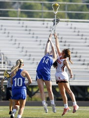 Michaela Elston (14) of Horseheads and Cailey Haynes of Union-Endicott battle for the draw May 23 during the Section 4 Class B girls lacrosse final at Corning Memorial Stadium.
