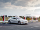 """With a combination of Tesla's """"Supercharger stations,"""""""