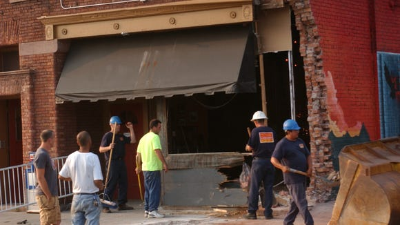 A crew cleans up after a truck crashed into Boulder Coffee on South Clinton Avenue and Alexander Street in 2006.