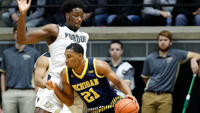 Caleb Swanigan steps up to block the path of Michigan's Zak Irvin Thursday, January 7, 2015, at Mackey Arena. Purdue defeated Michigan 87-70.